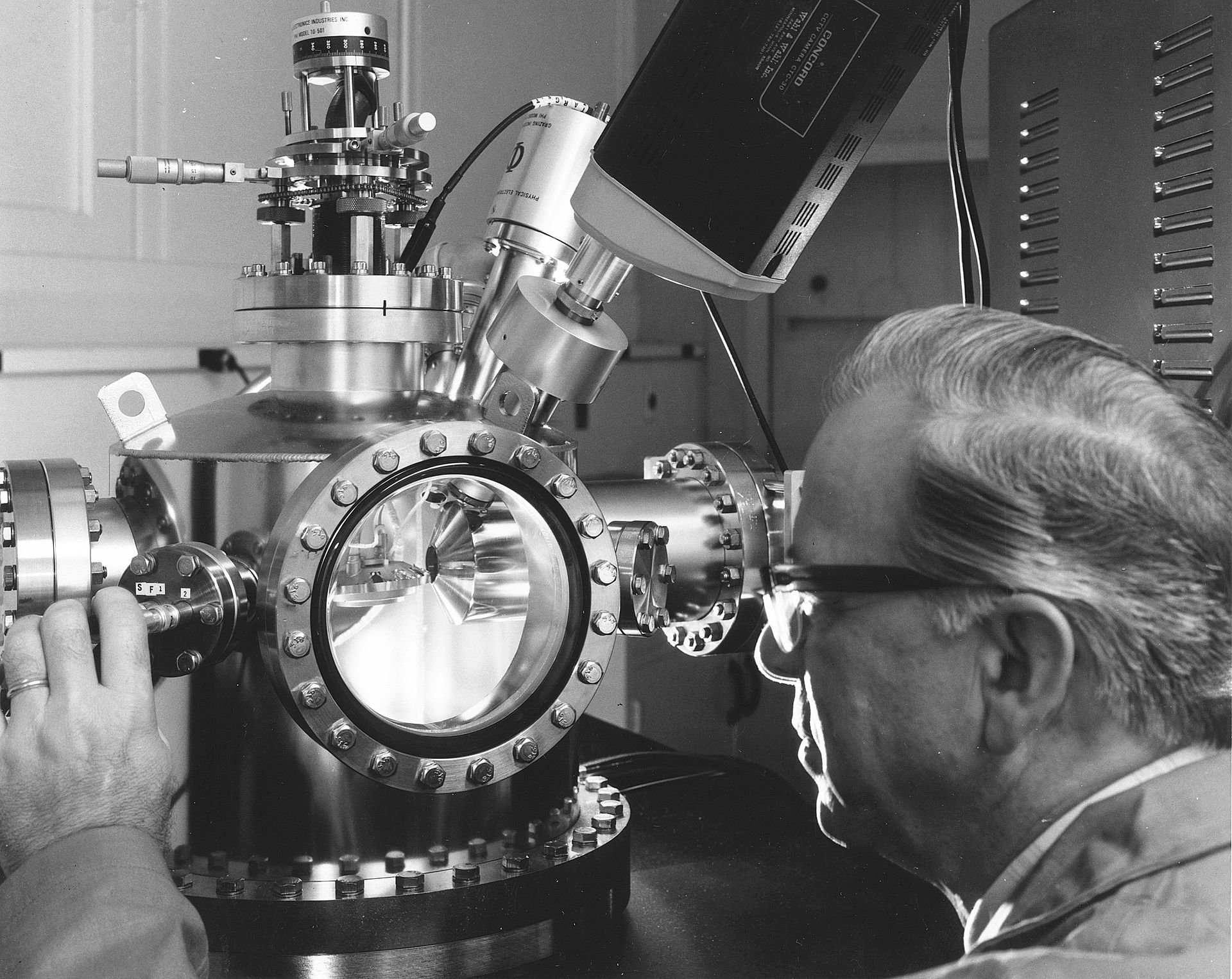 A Hanford scientist uses an Auger electron spectrometer to determine the elemental composition of surfaces.